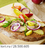 Купить «Sprat sandwich with pickled cucumber onion and peppers on the kitchen table», фото № 28500605, снято 14 января 2014 г. (c) Ingram Publishing / Фотобанк Лори