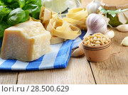 Купить «Ingredients and pesto sauce on the kitchen table», фото № 28500629, снято 24 июля 2019 г. (c) Ingram Publishing / Фотобанк Лори