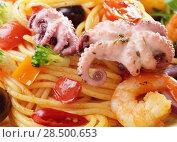 Купить «Seafood spaghetti marinara pasta with octopus, shrimps, cherry tomatoes and olives», фото № 28500653, снято 20 января 2014 г. (c) Ingram Publishing / Фотобанк Лори