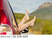 Купить «Female bare feet stick out of car window on mountain background. Travel concept.», фото № 28500669, снято 26 сентября 2013 г. (c) Ingram Publishing / Фотобанк Лори