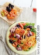 Купить «Seafood spaghetti marinara pasta dish with octopus, shrimps, cherry tomatoes and olives», фото № 28500689, снято 19 марта 2019 г. (c) Ingram Publishing / Фотобанк Лори