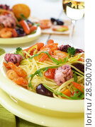 Купить «Seafood spaghetti pasta dish with octopus, shrimps, cherry tomatoes and olives», фото № 28500709, снято 26 апреля 2019 г. (c) Ingram Publishing / Фотобанк Лори