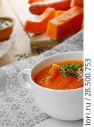 Купить «Homemade Thanksgiving Pumpkin Soup puree in white Bowl», фото № 28500753, снято 24 марта 2019 г. (c) Ingram Publishing / Фотобанк Лори