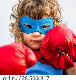 Купить «Superhero kid wearing boxing gloves against blue sky background. Girl power and feminism concept», фото № 28500817, снято 18 сентября 2013 г. (c) Ingram Publishing / Фотобанк Лори