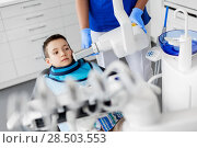 Купить «dentist making x-ray of kid teeth at dental clinic», фото № 28503553, снято 22 апреля 2018 г. (c) Syda Productions / Фотобанк Лори