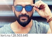 Купить «happy smiling man with beard on city street», фото № 28503645, снято 2 июня 2016 г. (c) Syda Productions / Фотобанк Лори