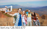 Купить «friends with backpack taking selfie by smartphone», фото № 28503677, снято 25 июля 2015 г. (c) Syda Productions / Фотобанк Лори