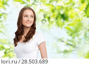 Купить «happy woman in white t-shirt», фото № 28503689, снято 17 апреля 2016 г. (c) Syda Productions / Фотобанк Лори