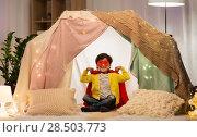 Купить «happy boy in super hero stuff in kids tent at home», фото № 28503773, снято 18 февраля 2018 г. (c) Syda Productions / Фотобанк Лори