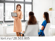Купить «woman showing tablet pc to business team at office», фото № 28503805, снято 17 марта 2018 г. (c) Syda Productions / Фотобанк Лори