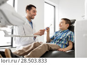 Купить «dentist giving toothbrush to kid patient at clinic», фото № 28503833, снято 22 апреля 2018 г. (c) Syda Productions / Фотобанк Лори