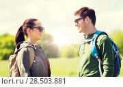 Купить «happy couple with backpacks hiking outdoors», фото № 28503881, снято 27 мая 2016 г. (c) Syda Productions / Фотобанк Лори