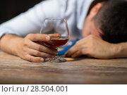 Купить «drunk man with glass of alcohol on table at night», фото № 28504001, снято 24 ноября 2017 г. (c) Syda Productions / Фотобанк Лори