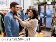Купить «couple choosing clothes at vintage clothing store», фото № 28504021, снято 30 ноября 2017 г. (c) Syda Productions / Фотобанк Лори