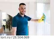 Купить «man in rubber gloves cleaning window with rag», фото № 28504069, снято 10 мая 2018 г. (c) Syda Productions / Фотобанк Лори