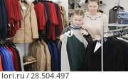 Купить «Happy teen girl looking for new clothing with her mum during family shopping», видеоролик № 28504497, снято 26 апреля 2018 г. (c) Яков Филимонов / Фотобанк Лори