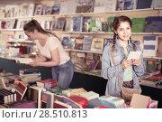 Купить «glad girl chatting on screen tablet and choosing literature books with mother», фото № 28510813, снято 9 мая 2017 г. (c) Яков Филимонов / Фотобанк Лори