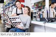 Купить «hairdresser edvise woman client about samples of hair dye», фото № 28510949, снято 31 марта 2018 г. (c) Яков Филимонов / Фотобанк Лори