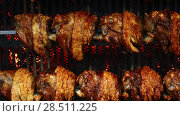 Купить «Pork knuckles slowly cooked at rotation grill», видеоролик № 28511225, снято 24 марта 2017 г. (c) Anton Eine / Фотобанк Лори