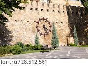 Купить «Clock on the wall of the old fortress. Baku city. Republic of Azerbaijan», фото № 28512561, снято 23 сентября 2015 г. (c) Евгений Ткачёв / Фотобанк Лори