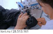 Купить «Professional tailor, fashion designer sewing clothes with sewing machine», видеоролик № 28513161, снято 13 апреля 2018 г. (c) Aleksey Popov / Фотобанк Лори