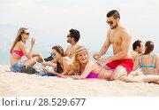 Купить «couple using cream for sunburn», фото № 28529677, снято 21 октября 2018 г. (c) Яков Филимонов / Фотобанк Лори