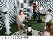 Five adults solving different conundrum in quest room. Стоковое фото, фотограф Яков Филимонов / Фотобанк Лори
