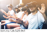 Купить «Excited man experiencing with friends virtual reality», фото № 28529961, снято 6 июля 2017 г. (c) Яков Филимонов / Фотобанк Лори