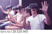 Купить «Excited man experiencing with friends virtual reality», фото № 28529965, снято 6 июля 2017 г. (c) Яков Филимонов / Фотобанк Лори
