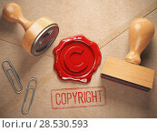 Купить «Copyright rubber stamp and sealing wax stamrp on the craft peper. Intellectual property and copyright concept.», фото № 28530593, снято 8 декабря 2018 г. (c) Maksym Yemelyanov / Фотобанк Лори