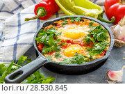 Купить «Shakshuka in a cast iron pan», фото № 28530845, снято 5 июня 2018 г. (c) Марина Сапрунова / Фотобанк Лори