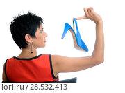 Купить «A short hair woman with a blue high heel in her right hand», фото № 28532413, снято 11 сентября 2011 г. (c) Ingram Publishing / Фотобанк Лори