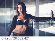 Portrait of young beautiful woman, model of fashion, wearing transparent shirt and black bra. Стоковое фото, фотограф Javier Sánchez Mingorance / Ingram Publishing / Фотобанк Лори