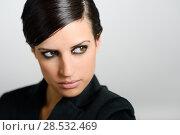 Купить «Portrait of woman with intense look on white background. Studio portrait», фото № 28532469, снято 14 февраля 2013 г. (c) Ingram Publishing / Фотобанк Лори