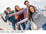 Купить «Group of multi-ethnic young people having fun together outdoors in urban background», фото № 28532481, снято 22 марта 2015 г. (c) Ingram Publishing / Фотобанк Лори