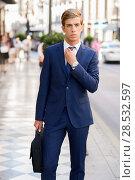 Купить «Portrait of an attractive young businessman in urban background wearing blue suit a necktie. Blonde hair», фото № 28532597, снято 17 сентября 2013 г. (c) Ingram Publishing / Фотобанк Лори