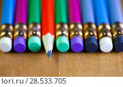 Купить «Pencils with an eraser on the end lie in a row. One pencil lies a core to us, small depth of sharpness», фото № 28533705, снято 5 марта 2016 г. (c) Куликов Константин / Фотобанк Лори