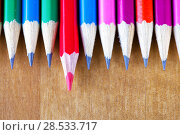Купить «Black lead pencils lie in a row, one pencil has a red core and put forward», фото № 28533717, снято 16 марта 2016 г. (c) Куликов Константин / Фотобанк Лори