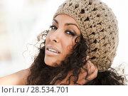 Купить «Portrait of a young black woman smiling with braces . Girl wearing wool cap.», фото № 28534701, снято 11 декабря 2011 г. (c) Ingram Publishing / Фотобанк Лори