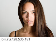 Купить «Beautiful young woman without make-up. Beautiful girl with green eyes, model of fashion wearing black tank top on white background.», фото № 28535181, снято 30 января 2016 г. (c) Ingram Publishing / Фотобанк Лори