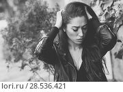 Купить «Close-up of a sad and depressed woman deep in thought outdoors. Girl with her hands on head. Black and white photograph.», фото № 28536421, снято 12 января 2016 г. (c) Ingram Publishing / Фотобанк Лори