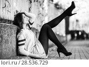 Купить «Portrait of funny female model of fashion with high heels sitting on the floor moving her legs», фото № 28536729, снято 28 января 2015 г. (c) Ingram Publishing / Фотобанк Лори