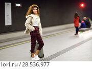 Купить «Young arabic woman waiting her train in a subway station. », фото № 28536977, снято 21 января 2018 г. (c) Ingram Publishing / Фотобанк Лори