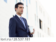 Купить «Businessman with formal clothes drinking coffee to go with a take away cup. Man wearing blue suit and tie in urban background.», фото № 28537181, снято 17 ноября 2016 г. (c) Ingram Publishing / Фотобанк Лори