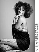 Купить «Young black woman with afro hairstyle laughing. Girl wearing black clothes. Studio shot. Black and white photograph», фото № 28537233, снято 14 июня 2016 г. (c) Ingram Publishing / Фотобанк Лори