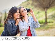 Купить «Two young tourist women taking photographs outdoors», фото № 28537305, снято 7 марта 2018 г. (c) Ingram Publishing / Фотобанк Лори