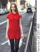 Купить «Young blonde woman walking in the street. Beautiful girl in urban background wearing red dress and black tights. Female with straight hair.», фото № 28537489, снято 11 декабря 2016 г. (c) Ingram Publishing / Фотобанк Лори