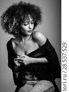 Купить «Sexy black woman with afro hairstyle. Girl wearing black shirt and blue jeans. Studio shot. Black and white photograph.», фото № 28537529, снято 14 июня 2016 г. (c) Ingram Publishing / Фотобанк Лори