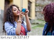 Купить «Portrait of two young black girls taking pictures of themselves through cellphone», фото № 28537617, снято 16 марта 2013 г. (c) Ingram Publishing / Фотобанк Лори