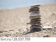 Купить «Pebbles in balancing on the sea coast», фото № 28537709, снято 22 февраля 2014 г. (c) Ingram Publishing / Фотобанк Лори